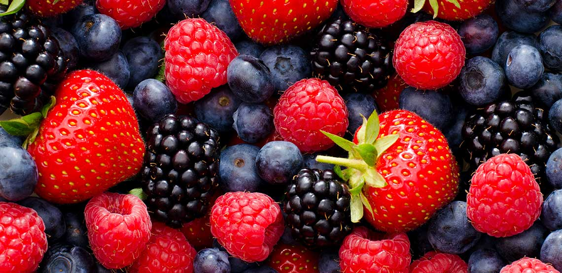 A pile of blueberries, strawberries, and raspberries