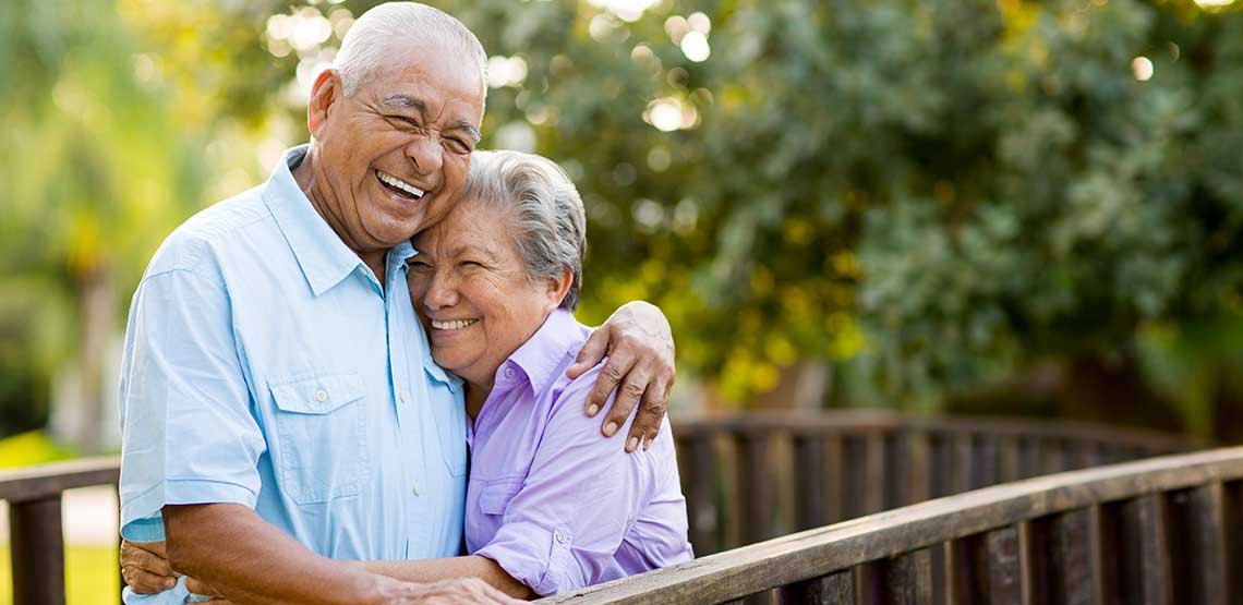 An older couple hugging each other