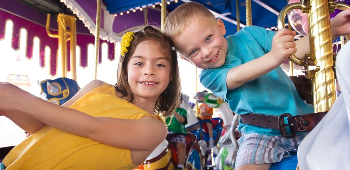 Two kids on a merry-go-round.