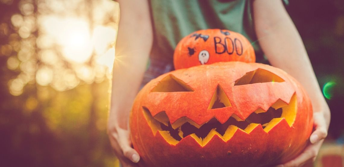 a carved pumpkin: an example of Halloween games for kids