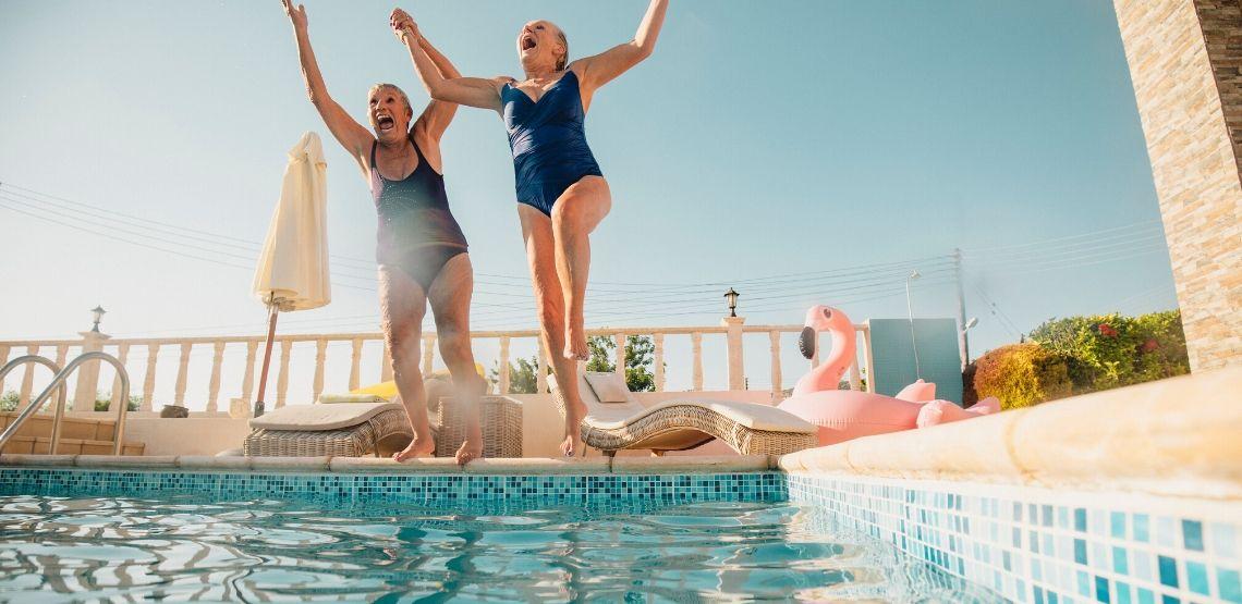 Two women going swimming.