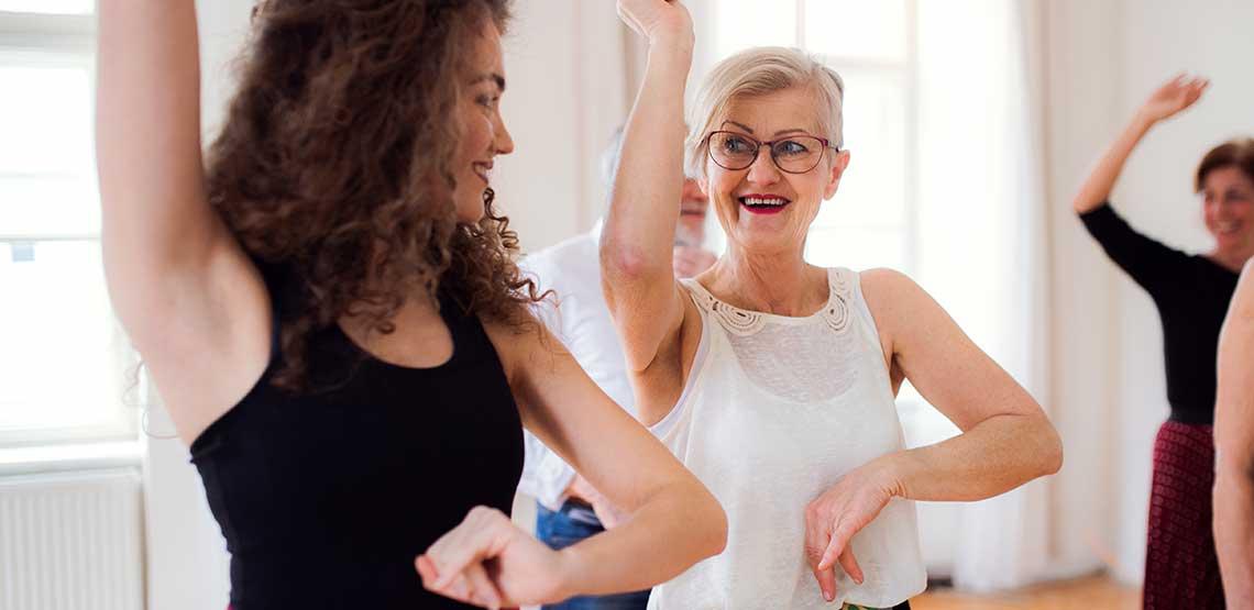 An older woman taking a dance class