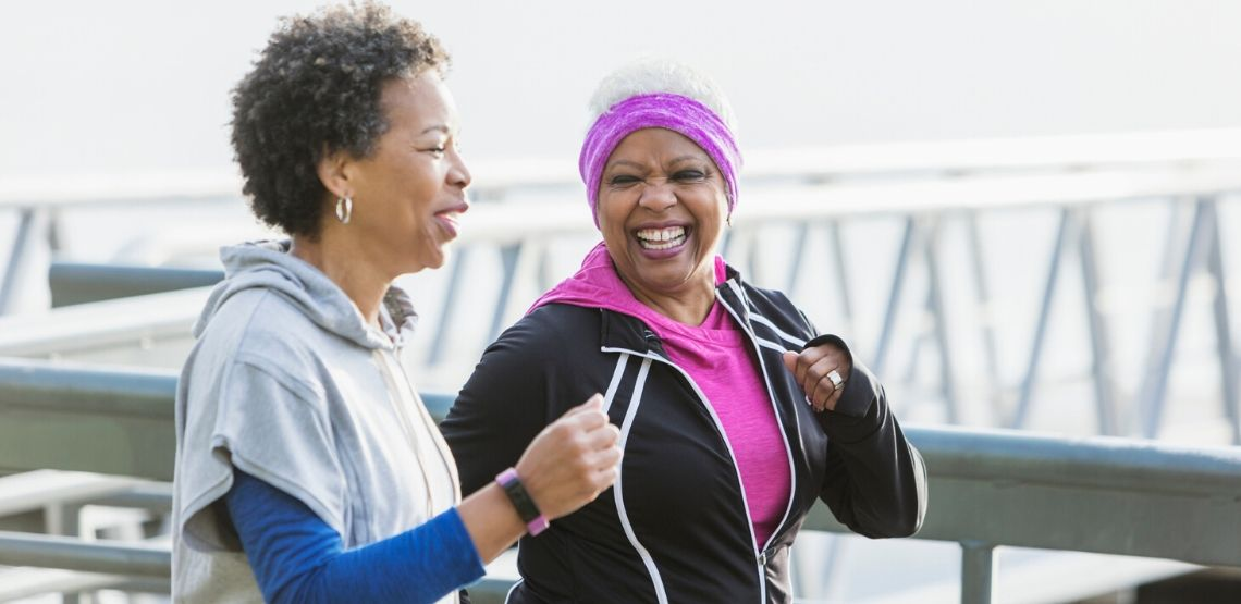 two senior women going for a run with wearable technology