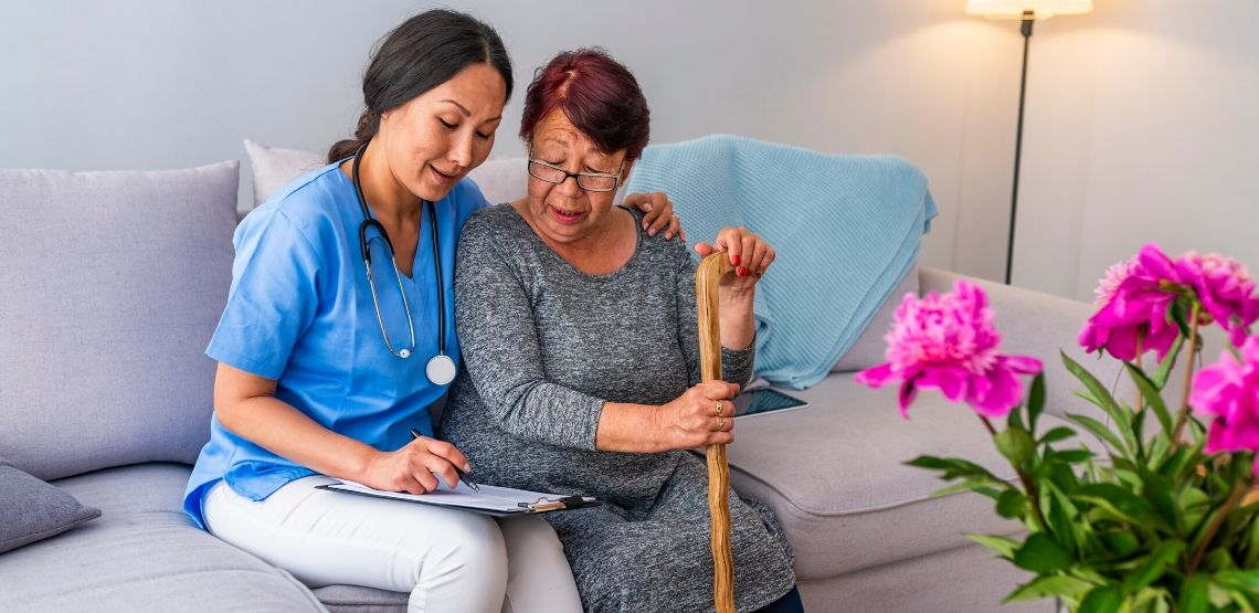 A caregiver talking to a senior.