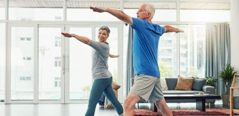 Two people doing stretches in their living room.